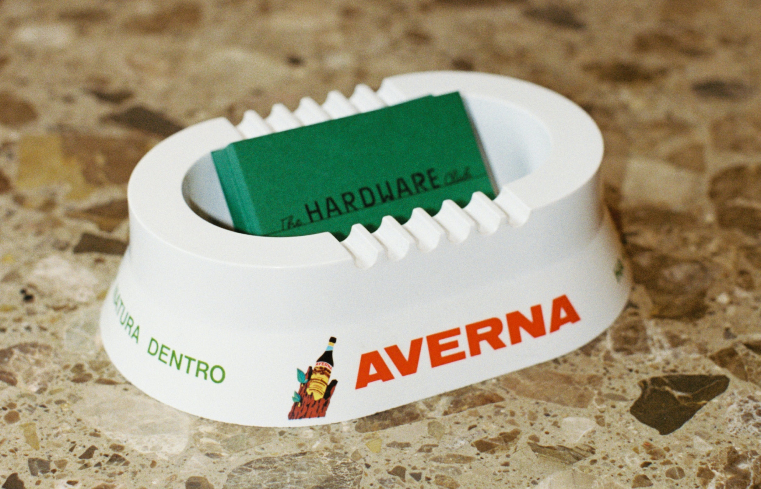 The Hardware Club business card by More Studio placed in a vintage Averna ashtray